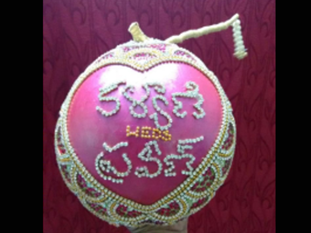 DECORATED COCONUT WITH NAMES FOR MARRIAGE