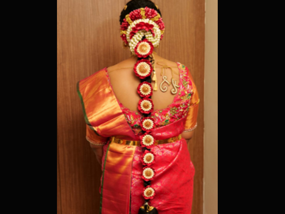 Pelli Poola Jada with flower pended for bride to look more beautiful